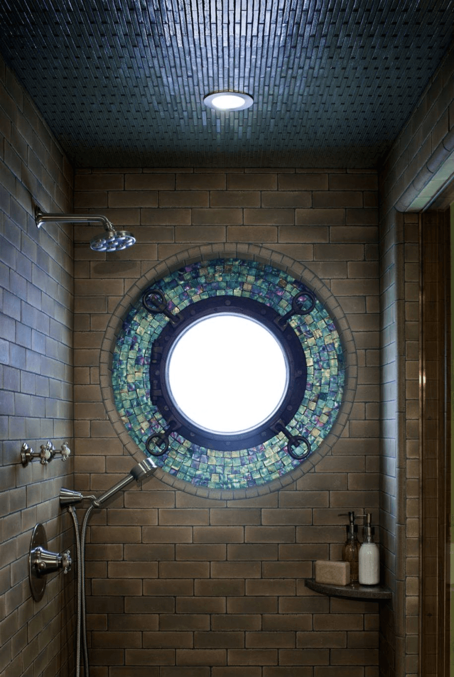 Mosaic ceramic tile window border in a shower