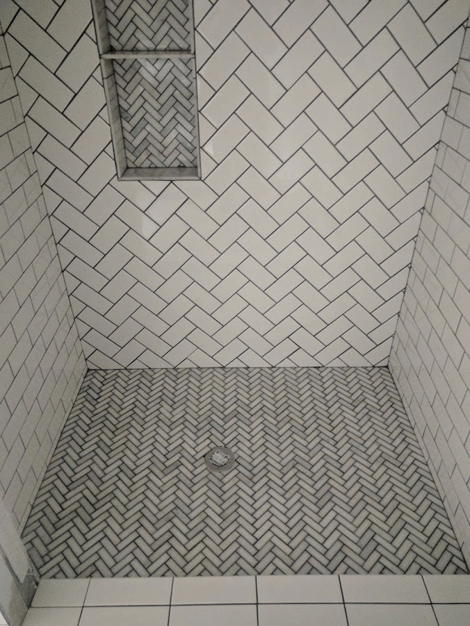 Ceramic shower tile in a chevron pattern