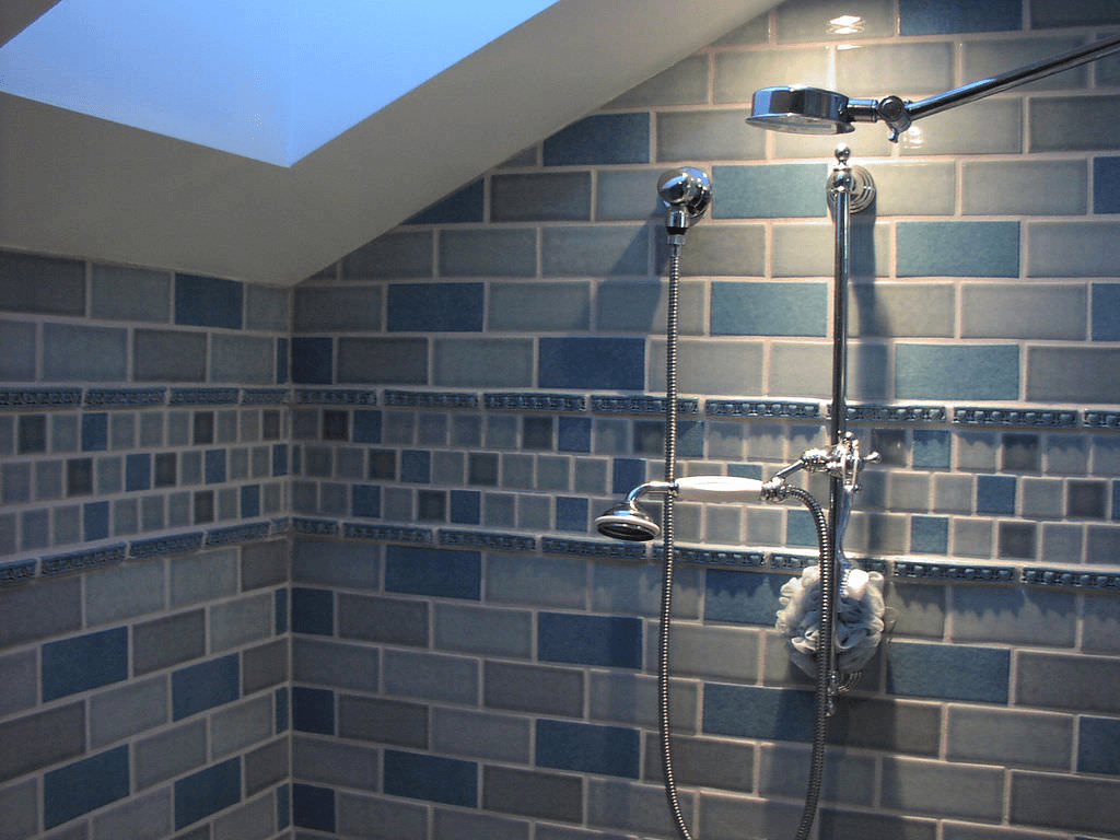 Blue ceramic shower tile with accents