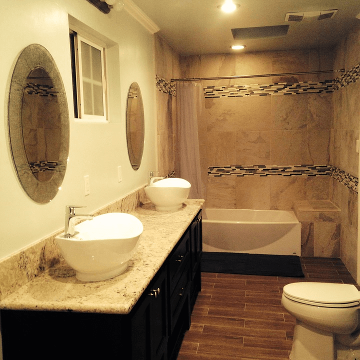 Mosaic ceramic tile accent rows on a shower wall
